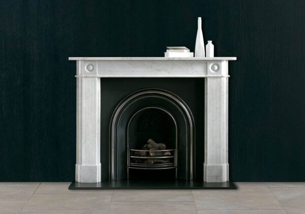 The Reeded Regency Bullseye - A Regency style marble surround having reeded jambs and frieze with bullseye capitals.