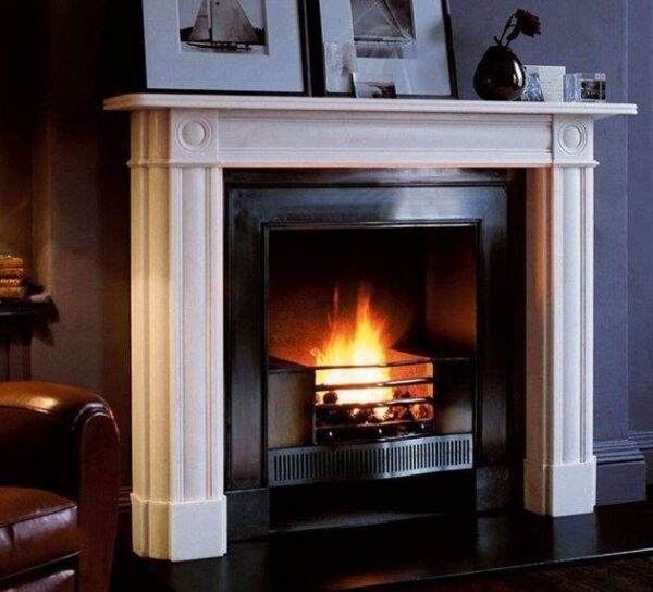 The Marble Regency Bullseye - The simple lines of the Regency period make the Marble Regency Bullseye an ideal fireplace for contemporary interiors. Cushion moulded pilasters and simple bullseye paterae create an elegant and understated design. Also available in optional sizes.
