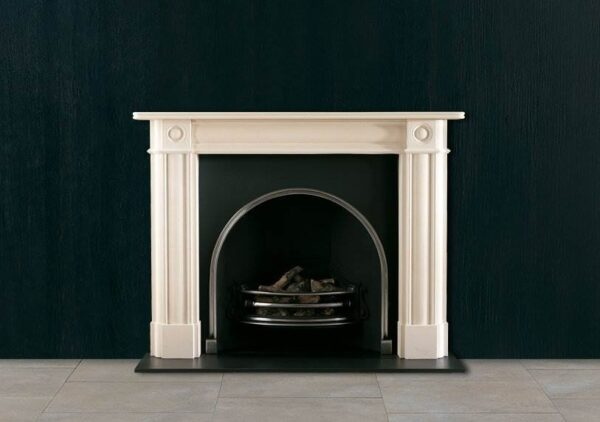 The Regency Bullseye - An English stone chimneypiece of early 19th century design, having moulded jambs and frieze with bullseyes to the capitals. Also available in optional sizes.