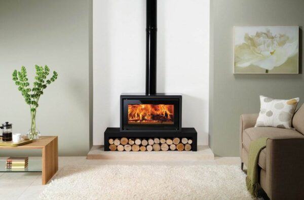 """Stovax Studio 1 Freestanding - The Stovax Studio 1 Freestanding incorporates the impressive firebox performance of a wood burning inset fire with the welcoming presence of a stove. Available with a number of optional extras to help you create the right look for your home, the Studio 1 Freestanding wood burning stove can be hearth mounted or installed on a?<a title=""""Studio Freestanding Bench"""" href=""""https://www.stovax.com/stove-fire/riva-studio-freestanding/riva-studio-freestanding-benches/"""">Studio Bench</a>. An optional heat shield kit can be fitted to the bench in order to reduce the distance to combustible materials if required."""