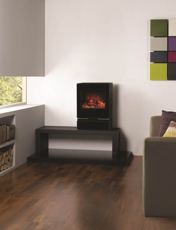 Gazco Vision Electric - The Gazco Vision is a contemporary, electric stove that comes in three sizes: Small, Midi and Medium; each sporting a highly reflective black glass door, integral glass plinth, black glass top plate and contrasting stainless steel detailing for a clean stylish look. Incorporating an eye-catching flame effect created using Gazco?s unique Veriflame? technology, the Vision?s alluring visuals glow over a realistic hand painted log-effect fuel bed to give all the ambiance and depth of a real log fire.