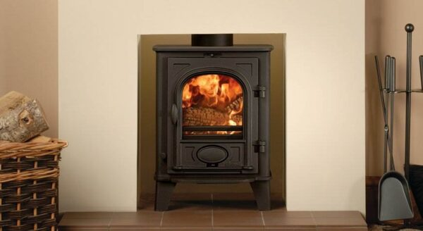 """Stovax Stockton 3 - The mini stove of the Stovax Stockton range is specifically designed to fit neatly into a standard 22""""(560mm) high x 16""""(405mm) wide British fireplace opening with the chairbrick removed. It has full multi-fuel capability which means that it is able to burn both logs and smokeless fuels. The compact dimensions of this wood burning and multi-fuel stove make it equally suitable for houseboats, summerhouses and garden workshops."""