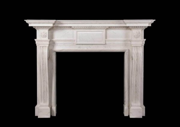 The Mansfield - A mid 18th century design of chimneypiece with robust console jambs beneath corner blocks carved with rosette, the frieze plain with a projecting central tablet beneath a carved breakfront shelf.
