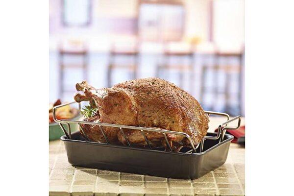 Large Stainless Steel Roasting Rack -  <ul>  <li>Holds roasts to one side for even convection air flow around the meats</li>  <li>Fits perfectly in the Big Green Egg Drip Pan</li>  <li>Doubles up to hold ribs upright</li>  <li>Easy to Clean</li>  <li><b>Not Suitable for the MiniMax</b></li> </ul>