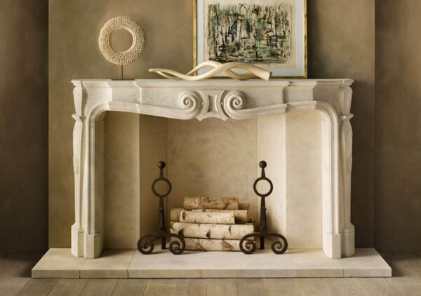 The Voltaire - The Randolph, an imposing hand carved limestone chimneypiece with an acanthus leaf carving centered on a dramatic gadrooned frieze.