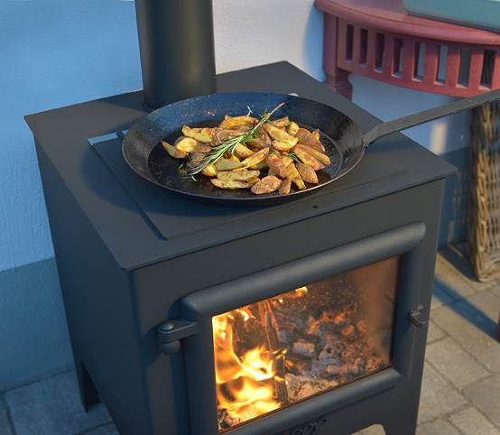 """Esse Garden Stove - <p style=""""vertical-align: baseline; margin: 0cm 0cm 19.2pt 0cm;""""><span style=""""font-family: &quot; color: #4e5768;"""">High quality outdoor stove by master stove makers ESSE with BBQ feature. The Esse Garden stove comes complete with a hotplate and a grill for fantastic wood fired cooking at its best. In stove mode with the hot plate swapped over for the grill this makes an ideal solution for keeping toasty on cooler summer evenings. Includes chimney and quick release placement wheels to assist with relocation in the garden. </span></p>  <h2 style=""""vertical-align: baseline; margin: 0cm 0cm 19.2pt 0cm;""""><span style=""""font-family: &quot; color: #4e5768;"""">Free ESSE Griddle pan with every ESSE Garden stove, offer ends 31st Jan 2021. Use code ESSEGRID at the checkout</span></h2> <p style=""""vertical-align: baseline; margin: 0cm 0cm 19.2pt 0cm;""""></p>"""