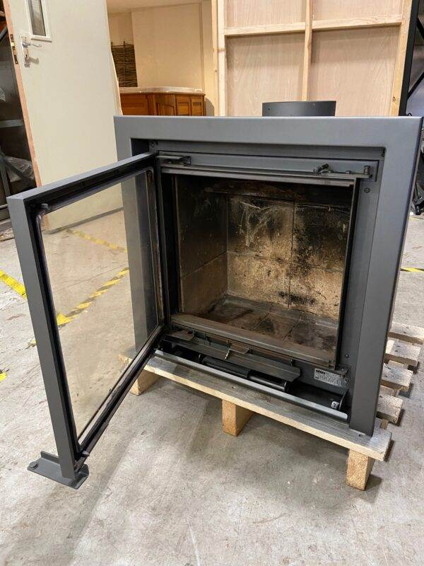 Stuv 16/58 Inset Used and refurbished - A narrow frame to cover up the stonework, a frame attached to hide the outline of the recess or a frame to be customised with the decorative elements of your choice.  <strong>Stuv Stoves - Stuv 16/58 Inset Wood Burning Stove reconditioned</strong>  Totally unique, the Stuv 16 Inset has a beautiful wide glass door to showcase the amazing view of the flames, without taking up any room.  Features Hinged door system - fitted with a hinged door to allows the fire to be refuelled WxH : 58x61cm Wood burning Efficiency - 78% Flue diameter - 180mm Output - 7kW Log size - up to 40cm horizontally Energy Efficiency class - A Purge air chases the smoke away from the window for a continuous view of the flames Large, wide window for epic flame picture A single control to adjust the 3 air supplies Double combustion: optimises the combustion of the wood and reduces the production of ash