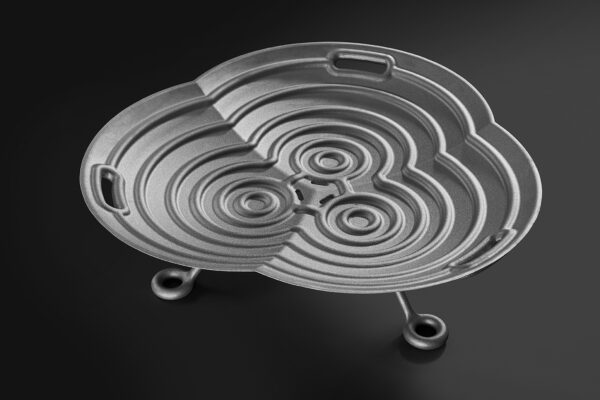 """Lotus Cast Aluminium Firebowl - Low - The Lotus has a basic three times repeating shape, with a total diameter of 100 cm. The function of the fire bowl is immediately recognised by the simplicity of design. The """"ridges"""" on the inside ensure that the logs do not slip. Even without fire, the Lotus is a beautiful decorative object for the garden. Lotus is available in a high and low version (with removable legs) in blasted untreated aluminium."""