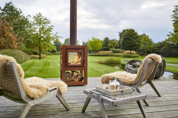 """RB73 Quaruba L Mobile - Outdoor Stove - <span lang=""""EN"""">The Quaruba model is astylishwood stove with an elegant appearance designed for outdoor use.</span><span lang=""""EN"""">This cube-shaped terrace stove has an unique modular construction and is therefore assembled as desired with 1 ( glass fronted door) to 4 glass panels.</span><span lang=""""EN"""">The door catch is located between the door panel and the right leg.</span><span lang=""""EN"""">The version with 4-wheels is easy moved. In addition, the platform for the wheels can also be used as storage for firewood.</span>"""