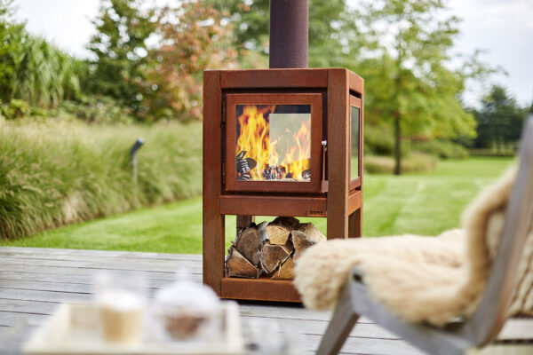 """RB73 Quaruba L Mobile - 4-Sided Outdoor Stove - <span lang=""""EN"""">The Quaruba model is astylishwood stove with an elegant appearance designed for outdoor use.</span><span lang=""""EN"""">This cube-shaped terrace stove has an unique modular construction and is therefore assembled as desired with 1 ( glass fronted door) to 4 glass panels.</span><span lang=""""EN"""">The door catch is located between the door panel and the right leg.</span><span lang=""""EN"""">The version with 4-wheels is easy moved. In addition, the platform for the wheels can also be used as storage for firewood.</span>"""