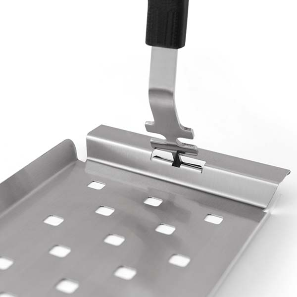Broil King Grid Lifter - Broil King®'s new simplified grid lifter removes both cast and stainless cooking grids in Broil King® grills. One set of tines to remove cast and another to remove stainless cooking grids. Stainless tip, resin handle.