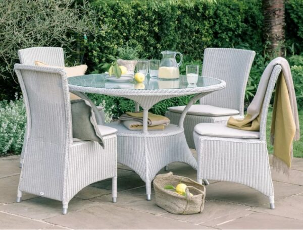 Neptune Chatto 4 Seater Round Table - Chatto is our classic English country garden furniture collection, suitable for using outside in the summer or else in a conservatory. It's made from Lloyd Loom – a material and making process that was especially popular in the early 20th century, giving Chatto its vintage aesthetic. This circular dining table will seat four people comfortably.