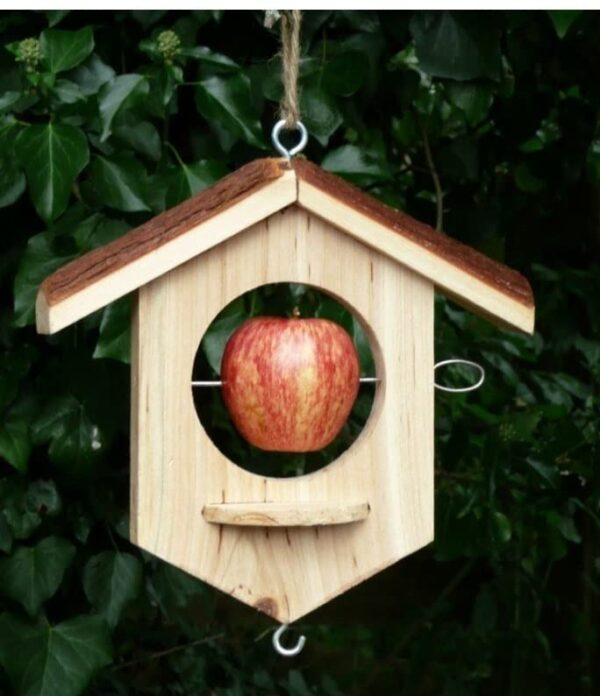 Wildlife World Apple House Feeder - An attractive and functional Apple House made from FSC (oak) wood with a rustic natural bark roof. The Apple House features a unique circular landing platform (which helps landing species to feed ) and steel spike, which can be used to fix a variety of foods from apples, to fat balls or bread to kitchen scraps.Siting:Hang from tree branches, pergolas etc, ideally in a visible, accessible location Features: Solid FSC timber Height: 230mm Width 220mm Depth 80mm
