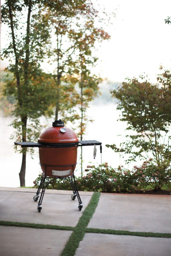 Kamado Joe - Classic - The kamado that set a new high standard for craftsmanship and innovation, our Kamado Joe Classic features a thick-walled, heat-resistant shell that locks in smoke and moisture at any temperature. Beneath the easy-open dome, a large cooking surface crafted from commercial-grade 304 stainless steel provides ample space for 10?12 fillets or chicken breasts. Other standard features include a flexible Divide & Conquer cooking system, a heavy-duty rolling cast iron cart, a precision ventilation dial and a patented slide-out ash drawer for easy access and cleaning.