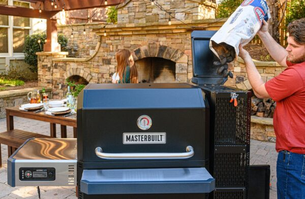 Masterbuilt Gravity Series 1050 Digital Charcoal Grill & Smoker - With the Gravity Series? 1050 Digital Charcoal Grill + Smoker by Masterbuilt, you can smoke, grill, sear, bake, roast and so much more. Set the temperature on the digital control panel or your smart device and the DigitalFan? maintains the desired cooking temperature. The GravityFed? charcoal hopper holds up to 8 hours of charcoal and gravity ensures you have constant fuel to the fire. The reversible smoke + sear cast-iron grates and FoldAway? warming + smoking racks add up to a total of 1050 square inches of cooking space. Master the art of charcoal grilling and smoking with Masterbuilt.