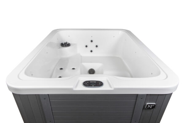 Novitek Ropi hot tub - Ropi is the newest member of the Standard product family. This compact outdoor hot tub is perfect for small spaces without compromising style or ergonomics. The hot tub's one upright seat and two lounge seats equipped with jets guarantee the perfect relaxation time after time. Ropi is white on the inside, and the cabinet is a beautiful grey composite panelling. <strong>Price increasing 1st October to £6495 inc Vat.</strong>