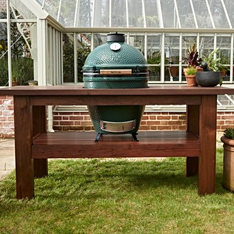Large Big Green Egg in Premium Mahogany Table- Full Bundle - A show stopping table for your EGG, made from sustainably sourced plantation mahogany - with plenty of surface space for prepping, resting and serving your flavourful creations. Comes with a Table Nest for your EGG to sit on so there's no risk of the wood getting scorched. <hr /> Call 01446 771567 to place an order.