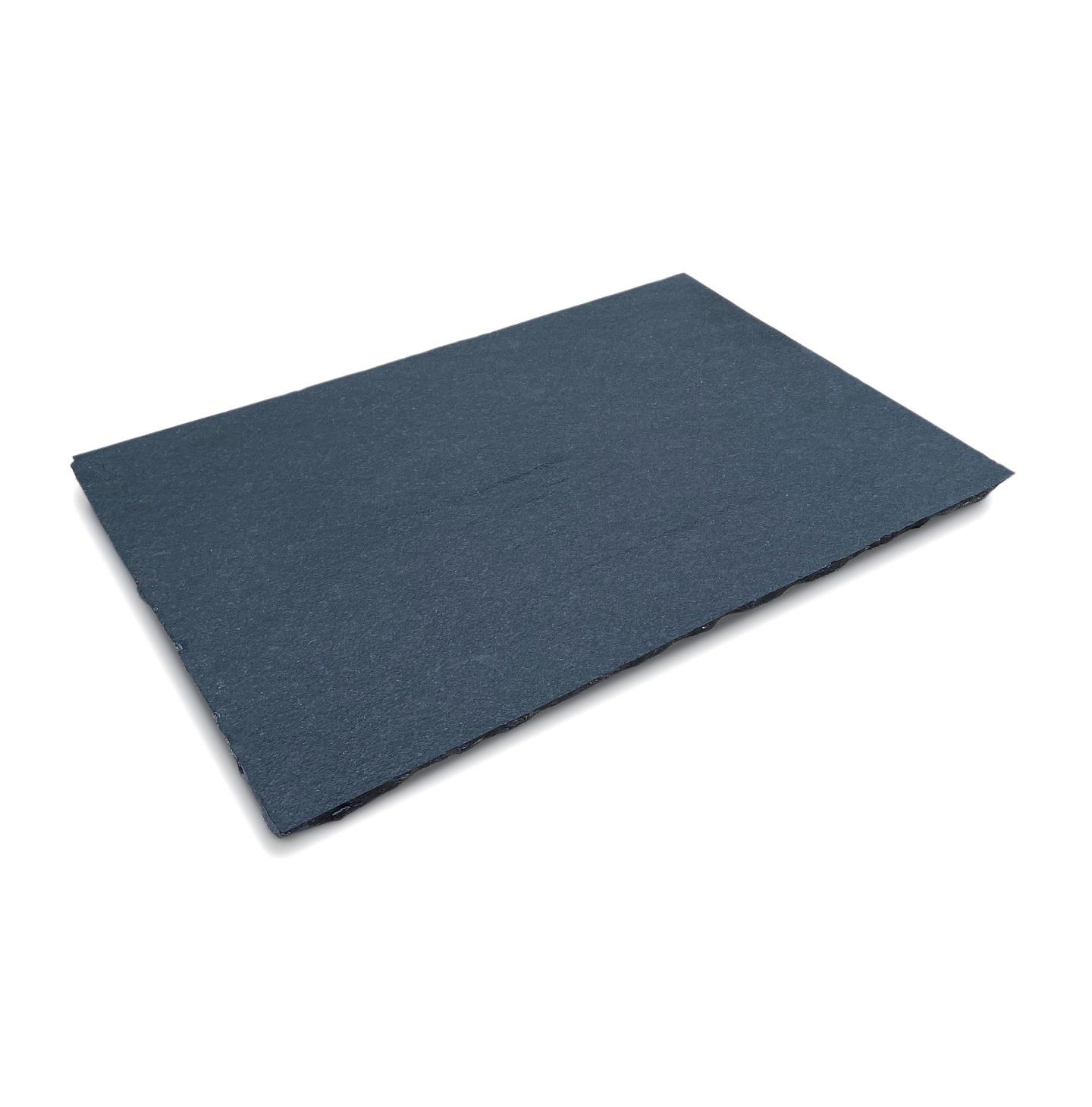Chipped edge black limestone hearth slab